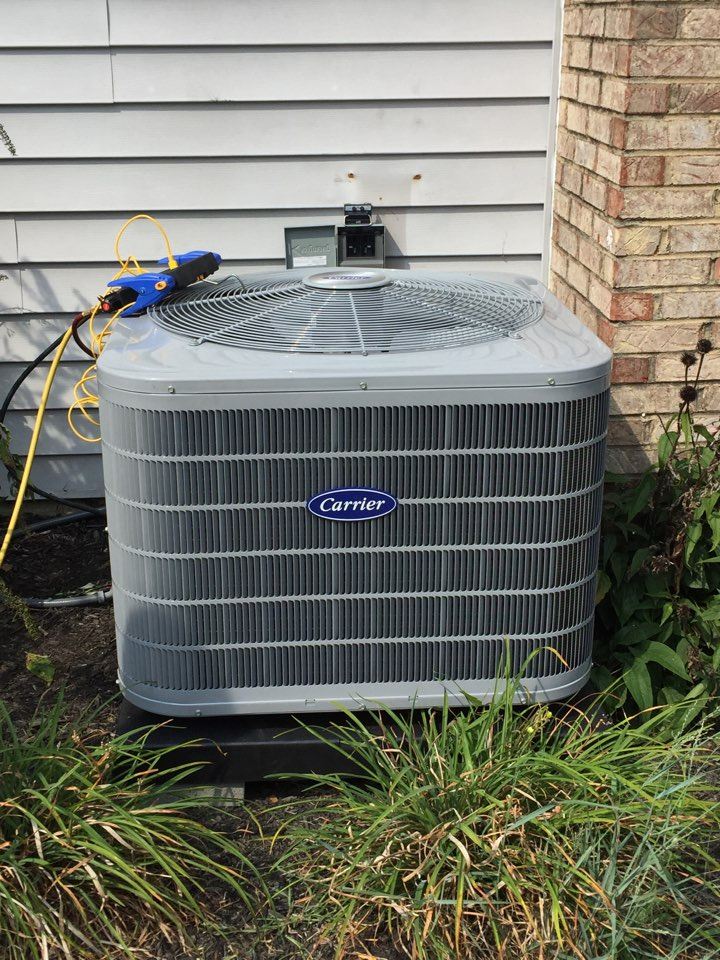 Hamilton, OH - Installing a Carrier 16 SEER central air conditioning system in Hamilton, OH