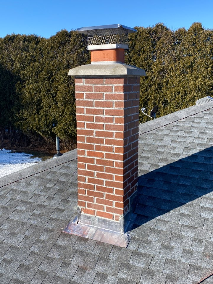 Griswold, CT - Brand new lead chimney flashing to top off this new roof!