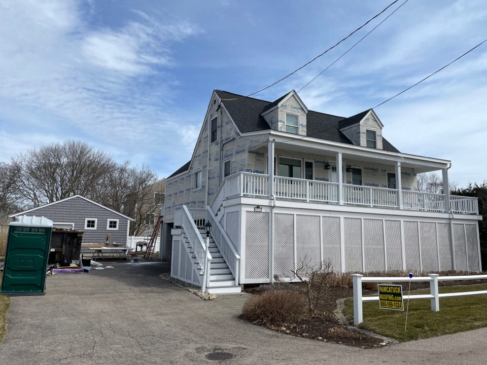 Stonington, CT - Install new Certainteed landmark pro series shingles charcoal color. Install new Certainteed 7 inch Cedar impressions in color driftwood. Install new PVC trim on all facia rakes and soffits. New PVC trim on all corners windows and doors.