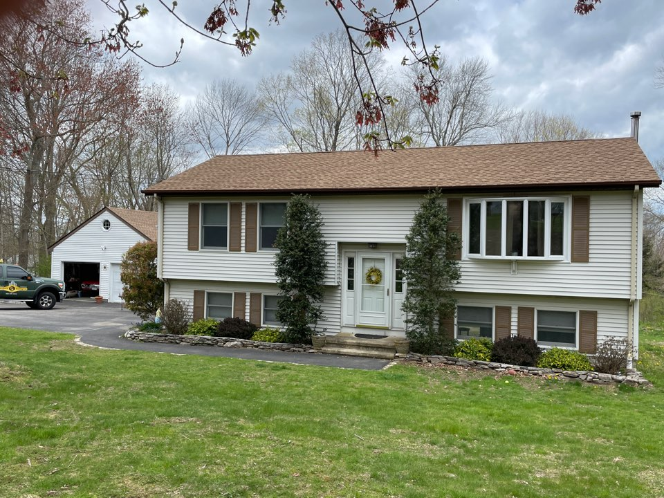 Salem, CT - Removed existing shingles. Installed a new GAF timberline shakewood roof system on house  and garage.