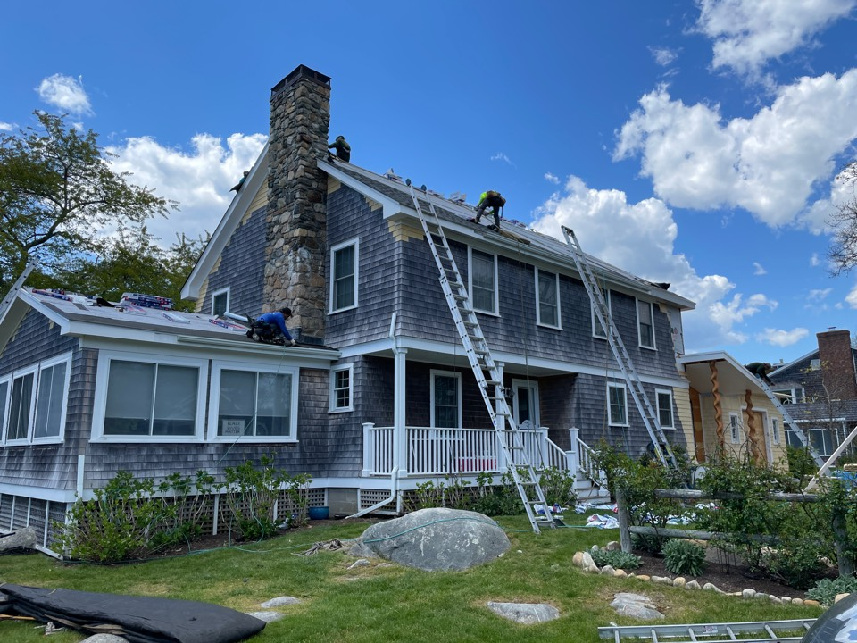 Charlestown, RI - Remove the existing roof shingles. Install New GAF pewter gray roof shingles. Install 4 new Velux venting Skylites a new construction addition
