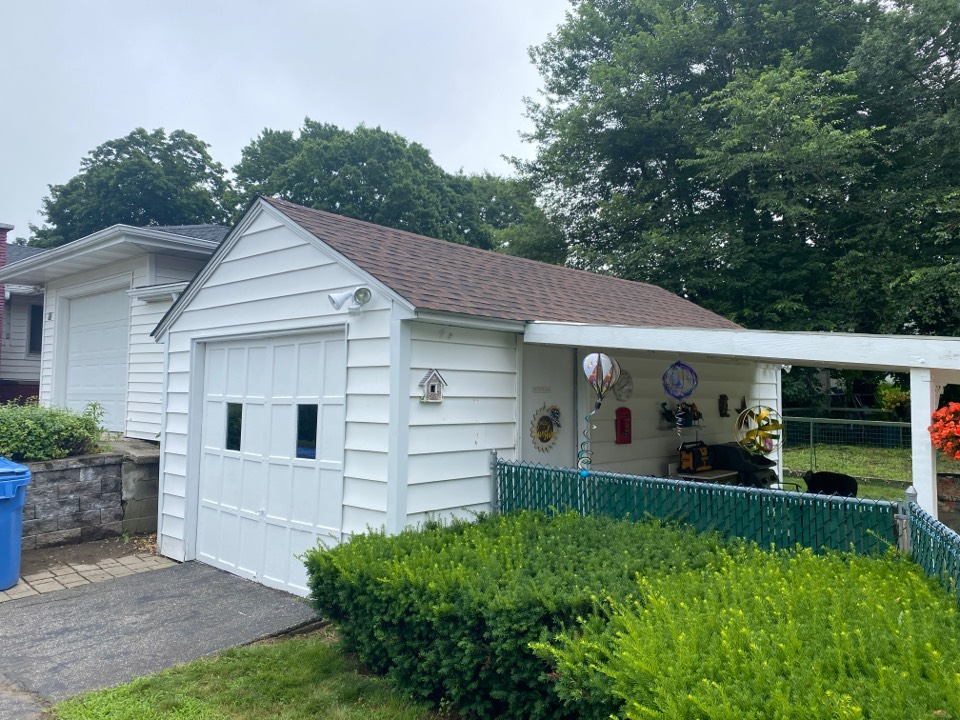 Norwich, CT - After removing 2 layers we put back on new underlayment and new GAF HDz Hickory shingles to complete this beautiful garage!