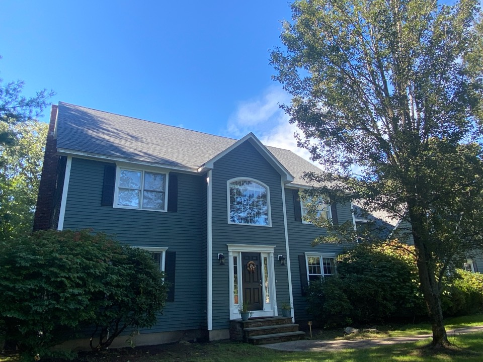 East Greenwich, RI - Beautiful new pewter gray GAF HDz roof with all new weather watch ice and water, felt busted synthetic underlayment, white aluminum drip edge, and cobra ridge vent to top it off! Now on to the gutters.
