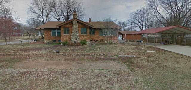 Arkansas City, KS - Working up an estimate for new seamless gutters in Arkansas City, KS.