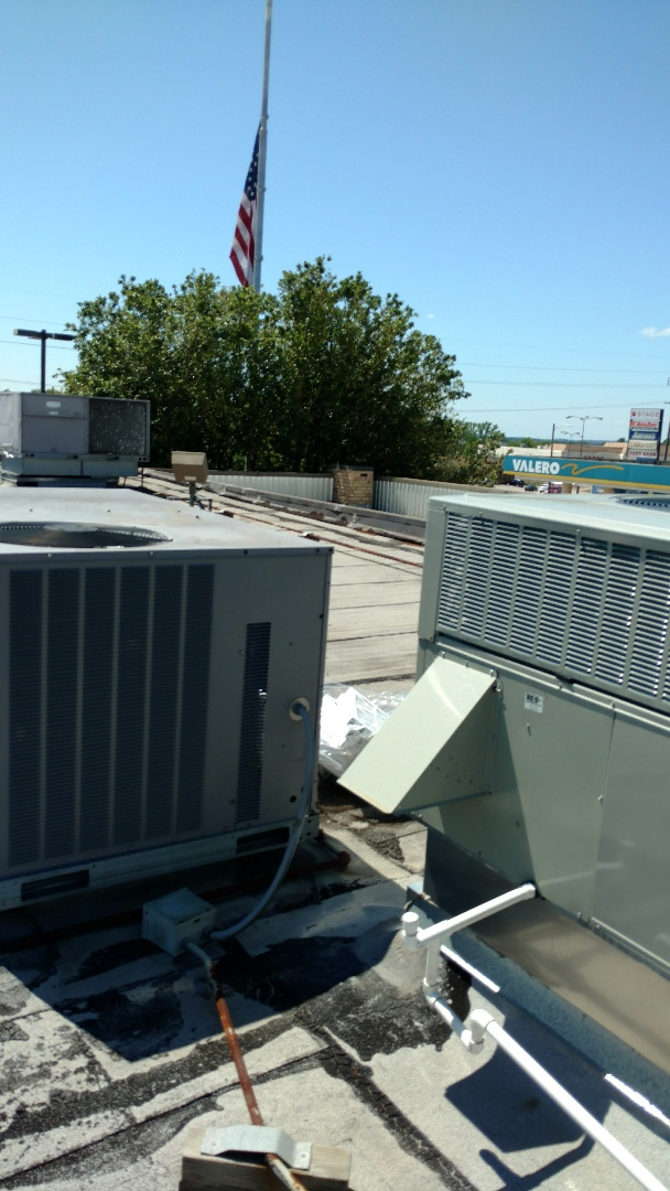 Henderson, TX - Working on a cooling maintenance on a roof