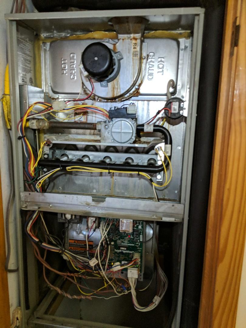 Tatum, TX - Performing a heating maintenance