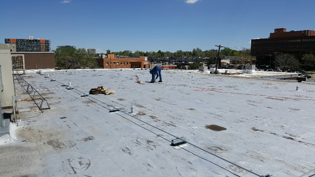 Denver, CO - Performing pull test on YMCA Schlessman roof. Getting prepared for full replacement.