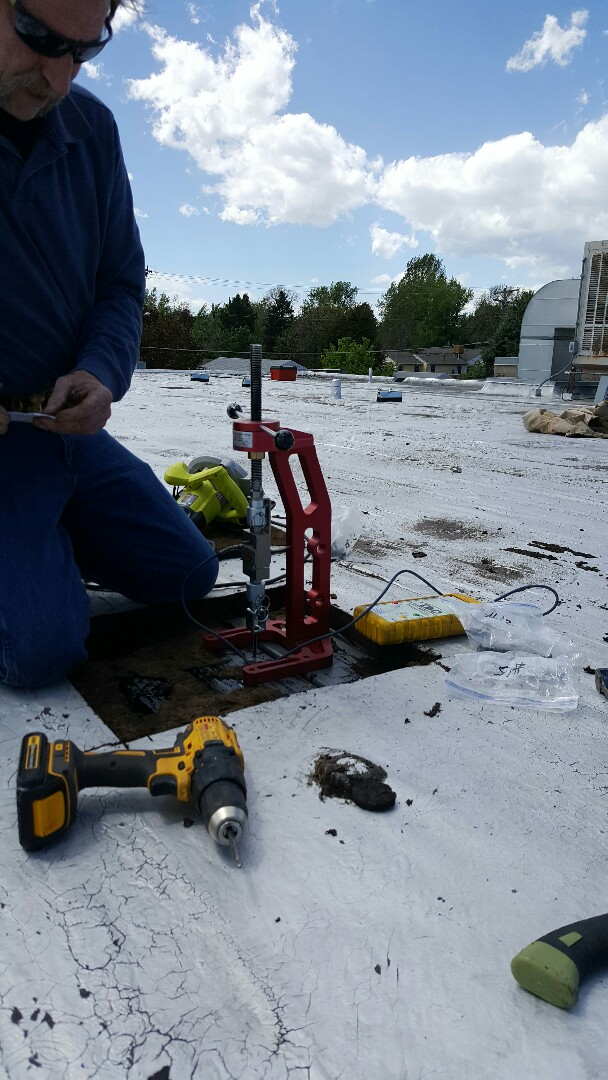 Denver, CO - Performing pull test at the YMCA Schlessman in Denver. Getting prepared for full roof replacement.