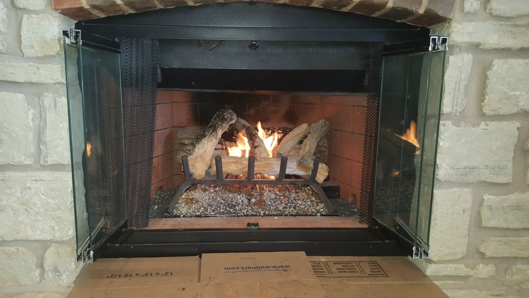 Edmond, OK - Gas fireplace repair service replacing pilot ignition system with new ignition system for pilot with new orifice that is correct size for fireplace heating system also recommended a.c. tune up for upcoming cooling season