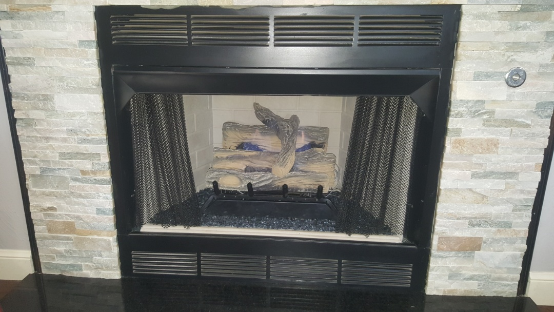 Doing repairs on a gas fireplace for residential home local resident after finding that ignition system needed renovation and repair for heating system fireplace is working excellent now