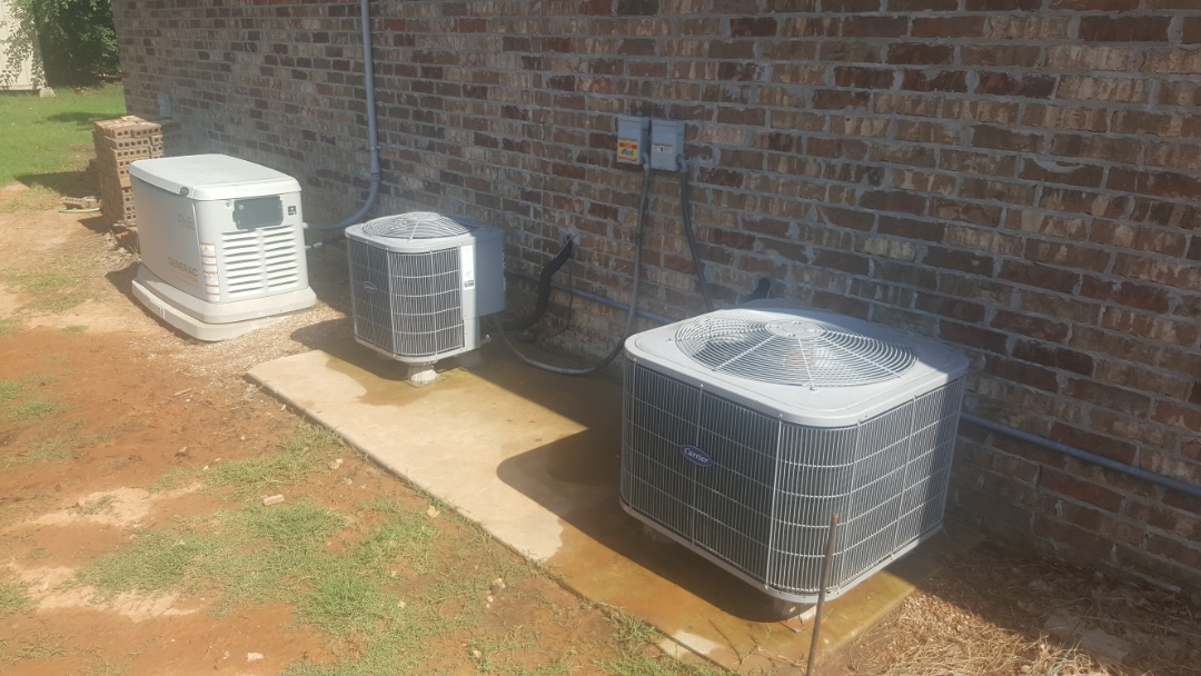 Edmond, OK - Repairing carrier AC condensing unit appears to be about a 2010 model air conditioner for the upstairs part of the home found that convincor fan motor was faulty and had a short in the windings as well as the voltage enhancement system run capacitors had faults in them as well so replacing those as well and also doing an upgrade on the fan blade as well as installing performance-enhancing upgrade hard start kit as well as AC renew by Nu Calgon and use cool cleaner to clean condensing coil