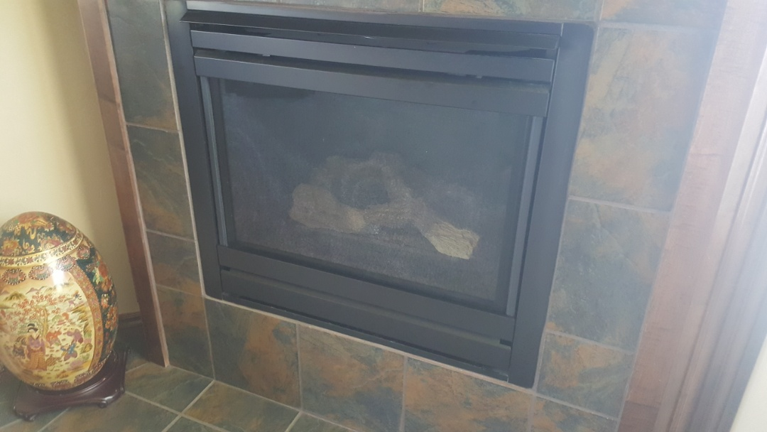 Oklahoma City, OK - Gas fireplace repair replacing dexen control module as well as replacing battery pack and D batteries for gas fireplace insert service repair for residential client homeowner gas fireplace is working perfect now