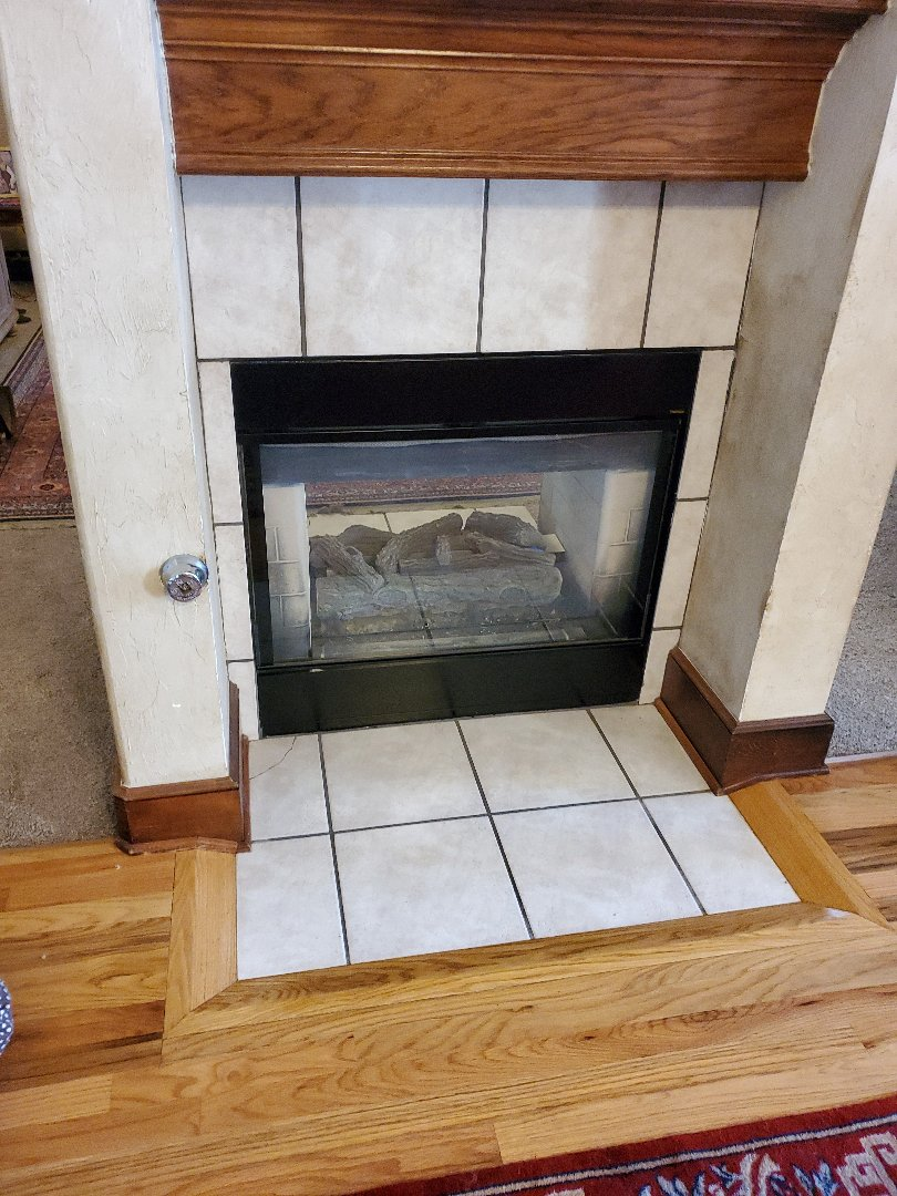 Edmond, OK - Performing planned maintenance inspection service For annual gas Fireplace Maintenance plan service contract Gas fireplace is operating under normal operating conditions according to manufacture