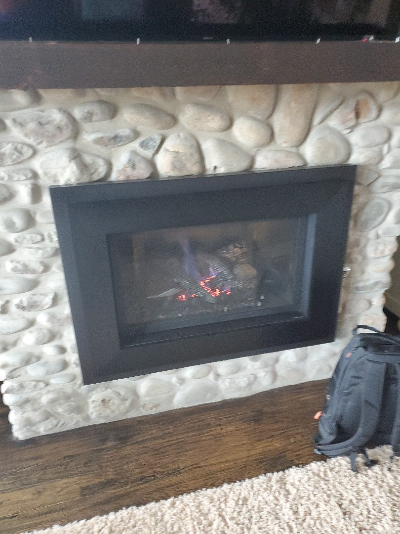 Edmond, OK - Servicing gas fireplace no repairs needed pilot not lighting fireplace is working great after resetting pilot ignition system