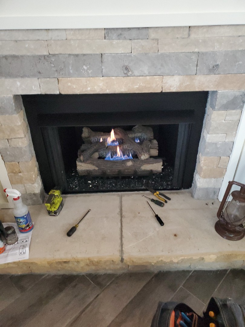 Gas fireplace repair converting to natural gas from propane