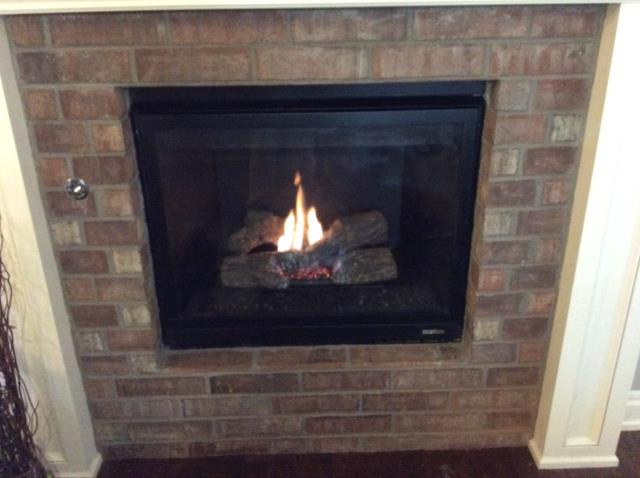 Oklahoma City, OK - Did Efficiency & Safety Restoration service on gas log fireplace for client.