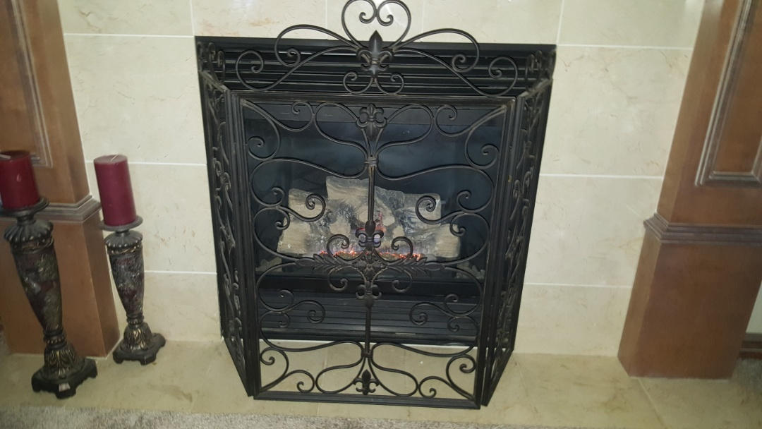 Edmond, OK - Doing gas fireplace repair and renovation on gas fireplace insert log set near I-35