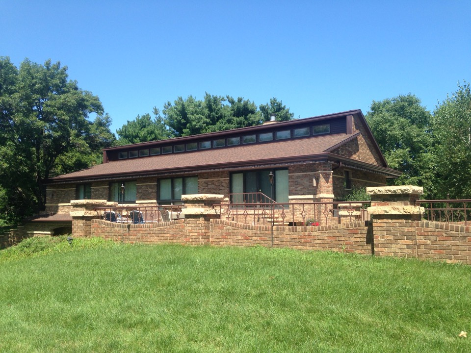 Waterloo, IA - New royal brown facia, 6 inch gutter and brown gutter helmet.