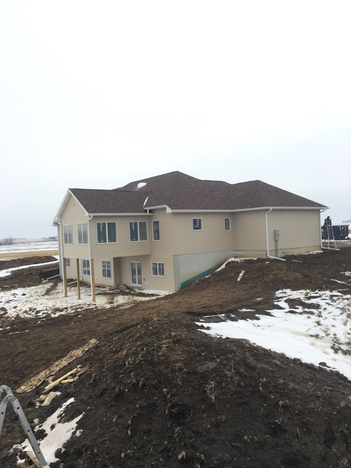 Waterloo, IA - Siding, soffit, facia and gutters on this new home.