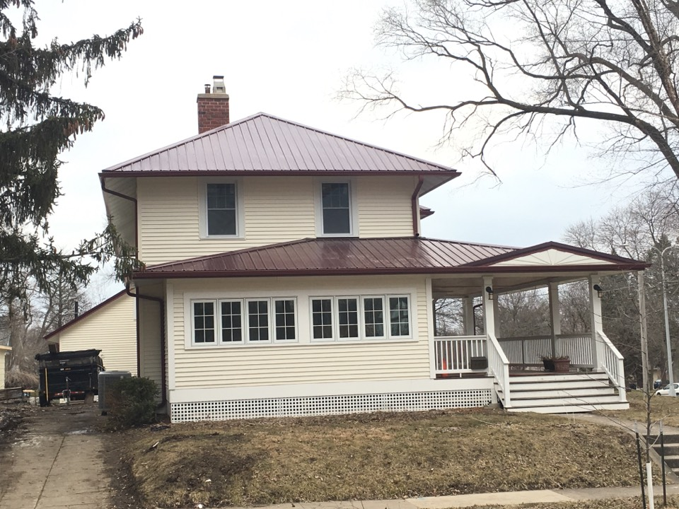Cedar Falls, IA - New siding, soffit, facia, and gutters on this two story remodel.