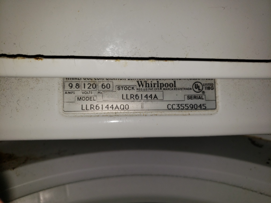 Lake Worth, FL - THE TECHNICIAN IS REPAIRING A WHIRLPOOL WASHER THAT LEAKS WATER.