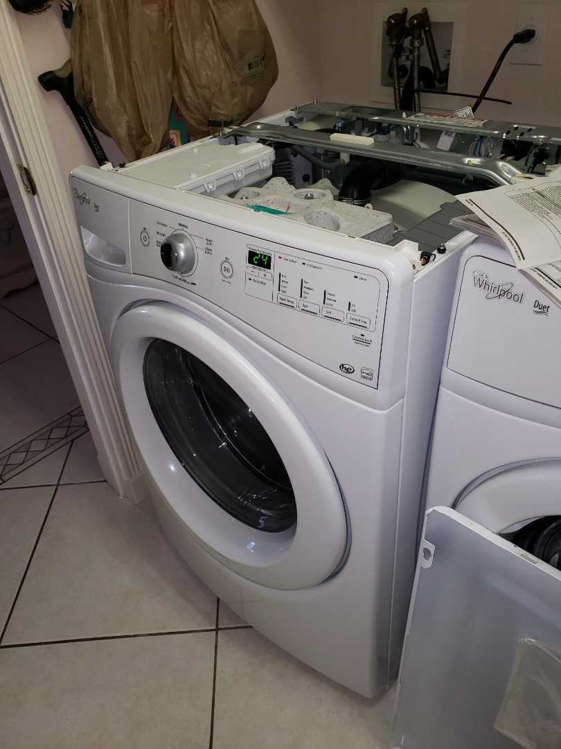 THE TECHNICIAN IS REPAIRING A WHIRLPOOL WASHER.