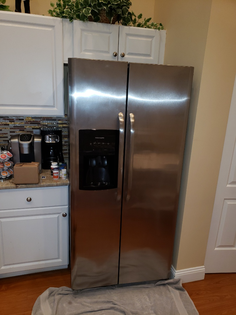 Tamarac, FL - THE TECHNICIAN IS REPAIRING A FRIGIDAIRE REFRIGERATOR.