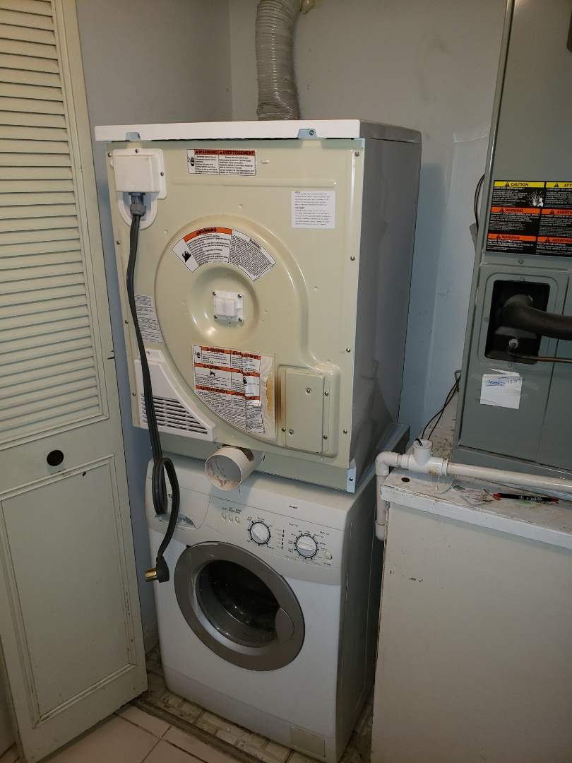 Lake Worth, FL - THE TECHNICIAN IS REPAIRING A WHIRLPOOL DRYER.