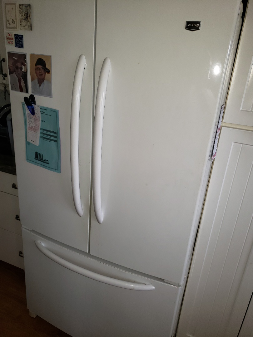 Boca Raton, FL - THE TECHNICIAN IS REPAIRING A MAYTAG REFRIGERATOR NOT COOLING.