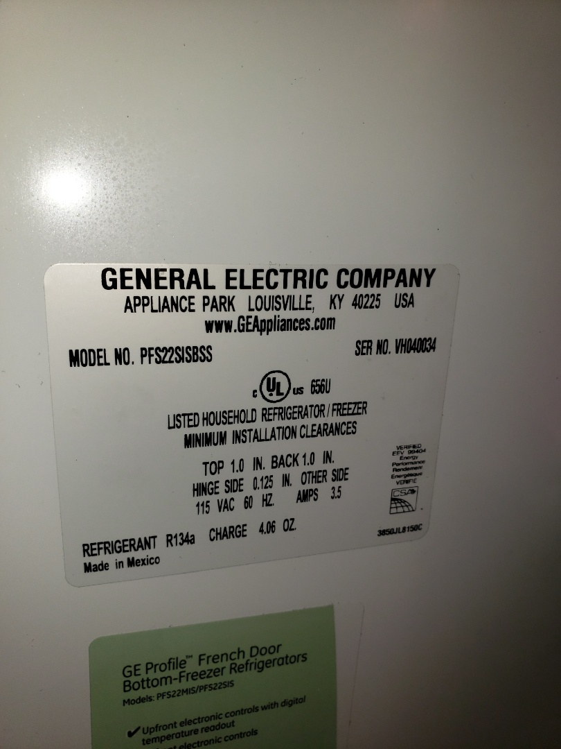 The TECHNICIAN is REPAIRING A GENERAL ELECTRIC REFRIGERATOR