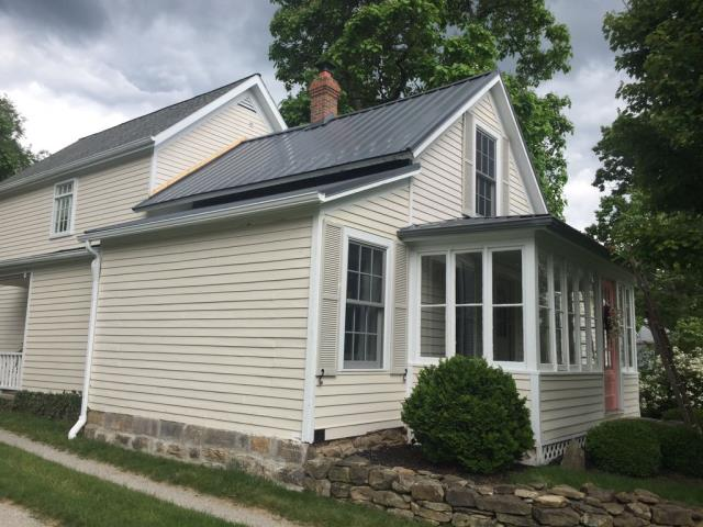Richfield, OH - We installed a new Charcoal Gray Standing Seam Metal Roof on this older home.