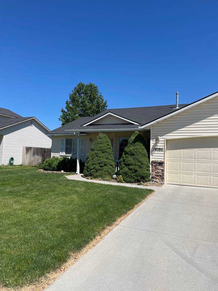 Caldwell, ID - Inspection on residential roof for possible insurance claim. Roof is old and needs replaced. Wind damage on front slope.