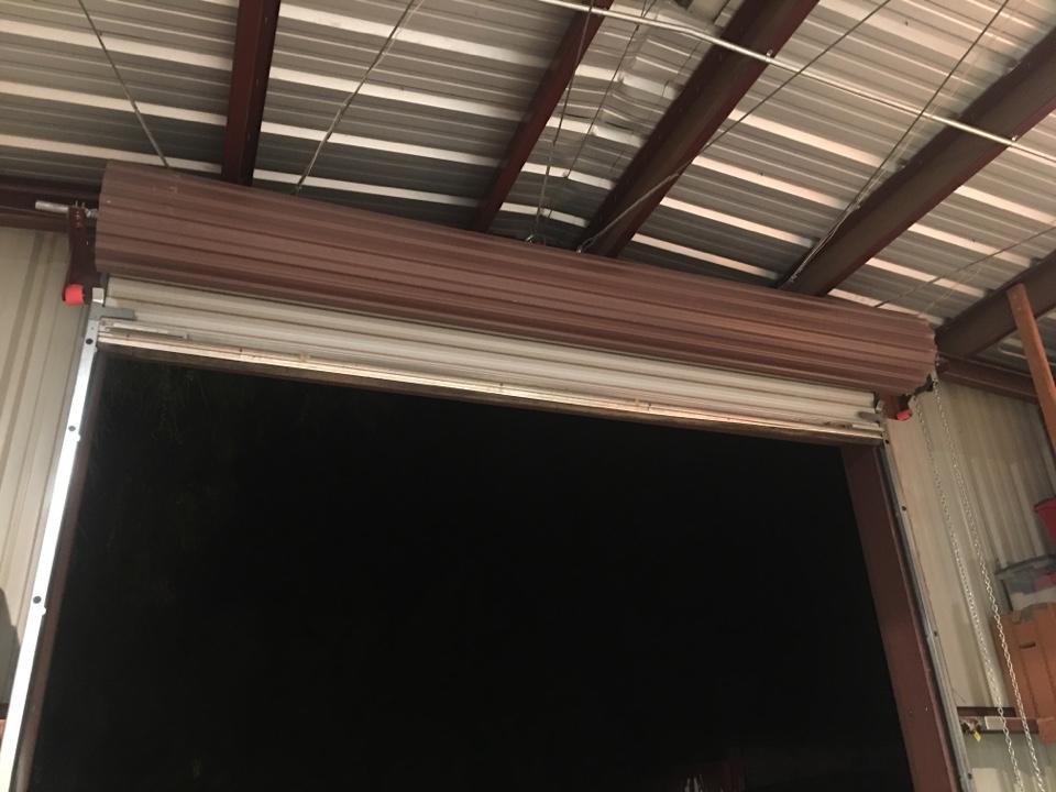 Cave Creek, AZ - Customer's door was stuck open. Bottom retainer kept getting stuck. Rolled door up & down & noticed it kept rubbing on guide. Cut retainer in an angle. Tested door multiple times and door works great.