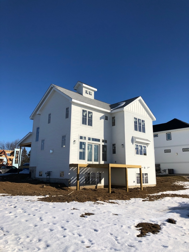 Waunakee, WI - Almost done with James Hardie Arctic White Siding on this home...
