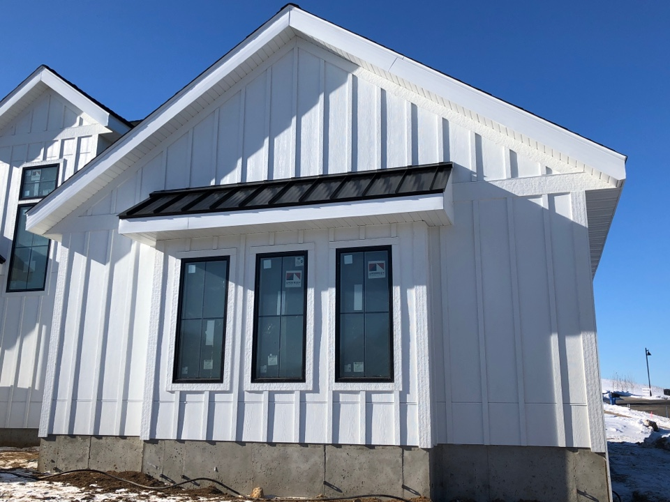 Waunakee, WI - Metal roof just finished up on this beautiful James Hardie Arctic White home.