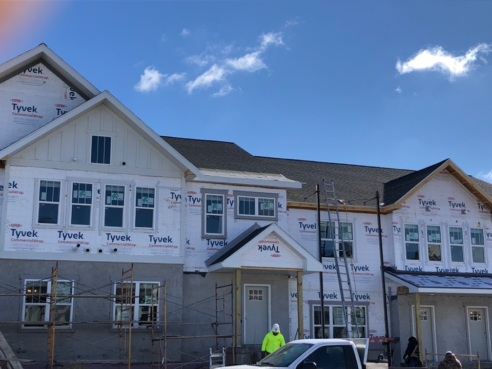 Fitchburg, WI - Weather permitting we will be finishing up siding on this 8 unit new construction. James Hardie Pearl Gray