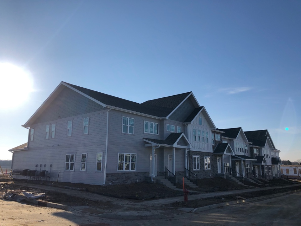 Fitchburg, WI - Just wrapped up siding on this 8 unit. James Hardie Pearl Gray Arctic white