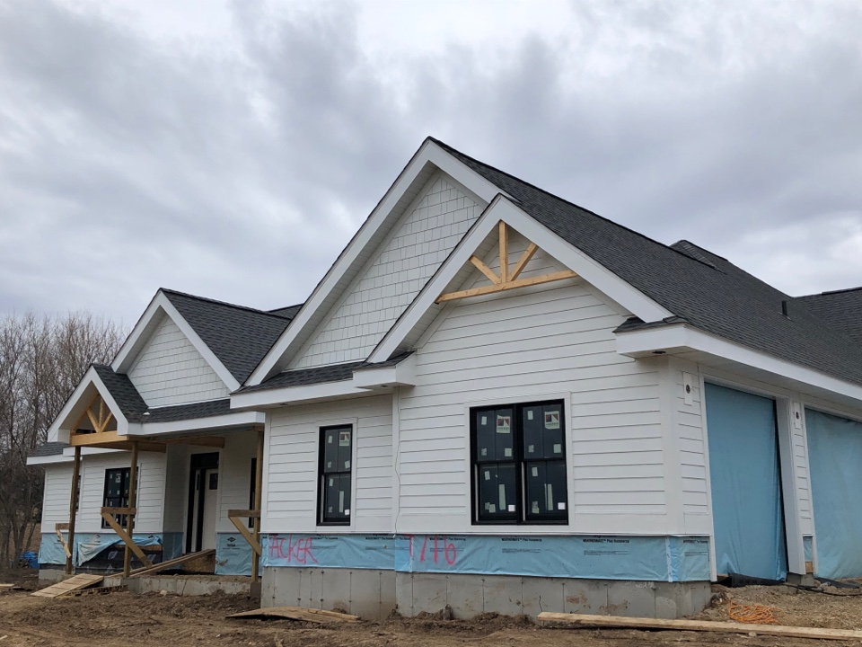 Middleton, WI - Just wrapping up siding on this beautiful James Hardie Arctic White home.