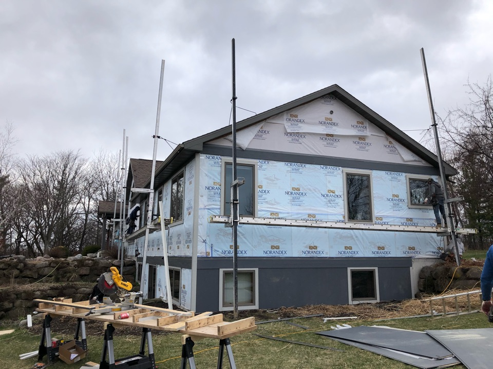 Waunakee, WI - Reside started today. LP Smartside Craven Steel and Quarry Gray trim.