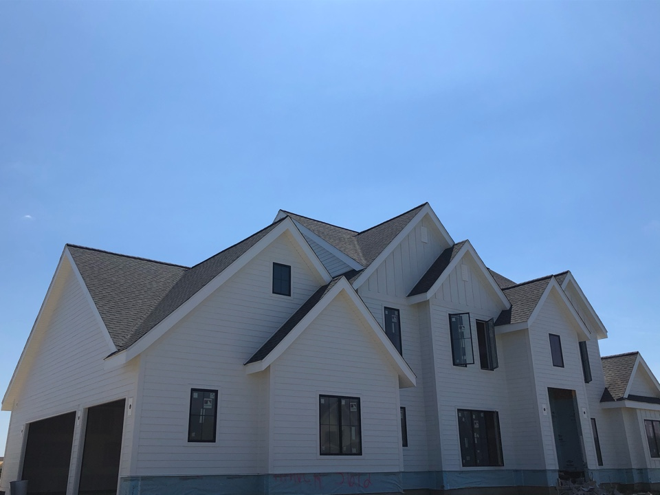 Waunakee, WI - Finished siding on this amazing home over the holiday weekend. James Hardie Arctic White