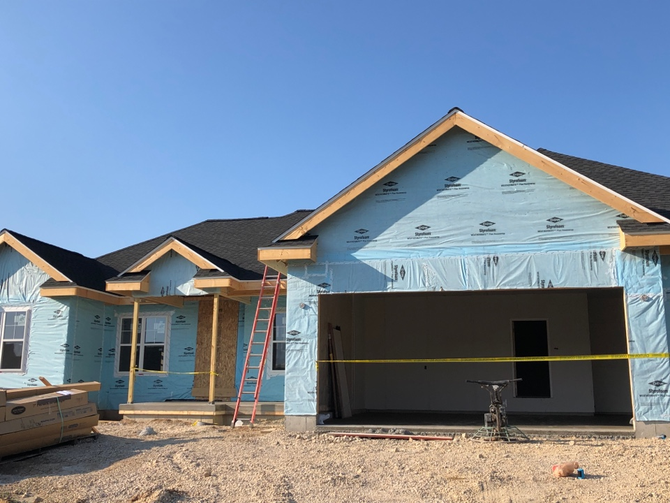 Waunakee, WI - Setting up for siding this morning!