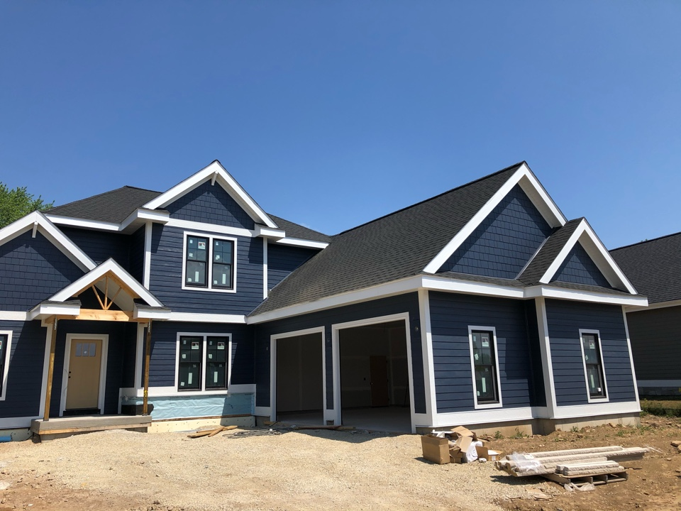 Waunakee, WI - Just finished siding this James Hardie-Deep Ocean custom home.