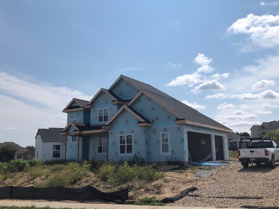 Oregon, WI - Roof complete. Up next: siding.