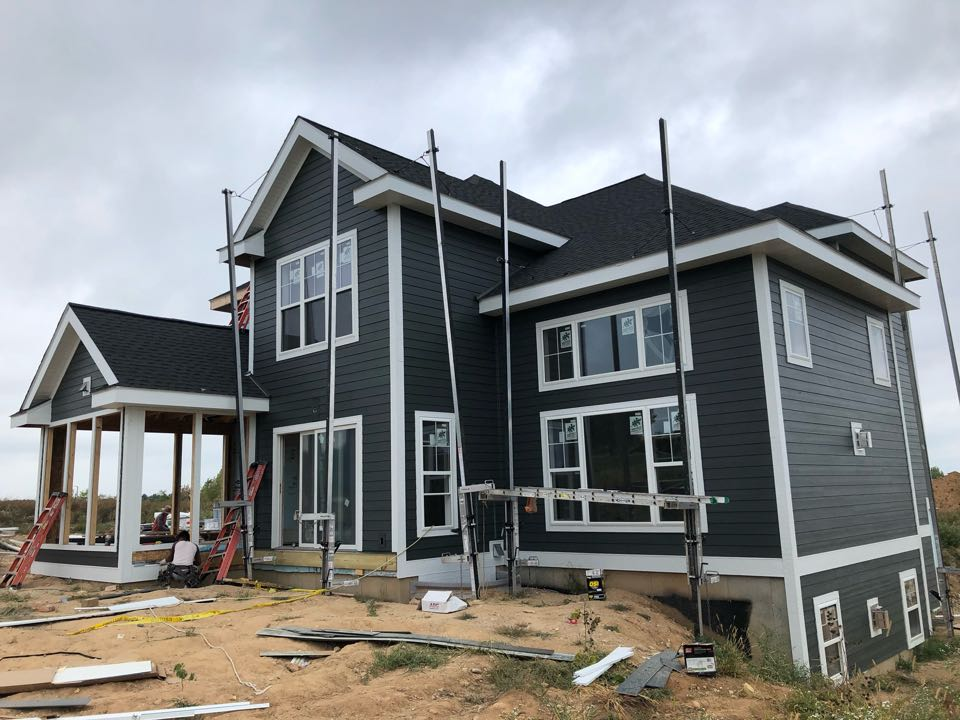 Oregon, WI - Good progress over the weekend on this project! James Hardie Iron Gray lap siding and Arctic White trims.