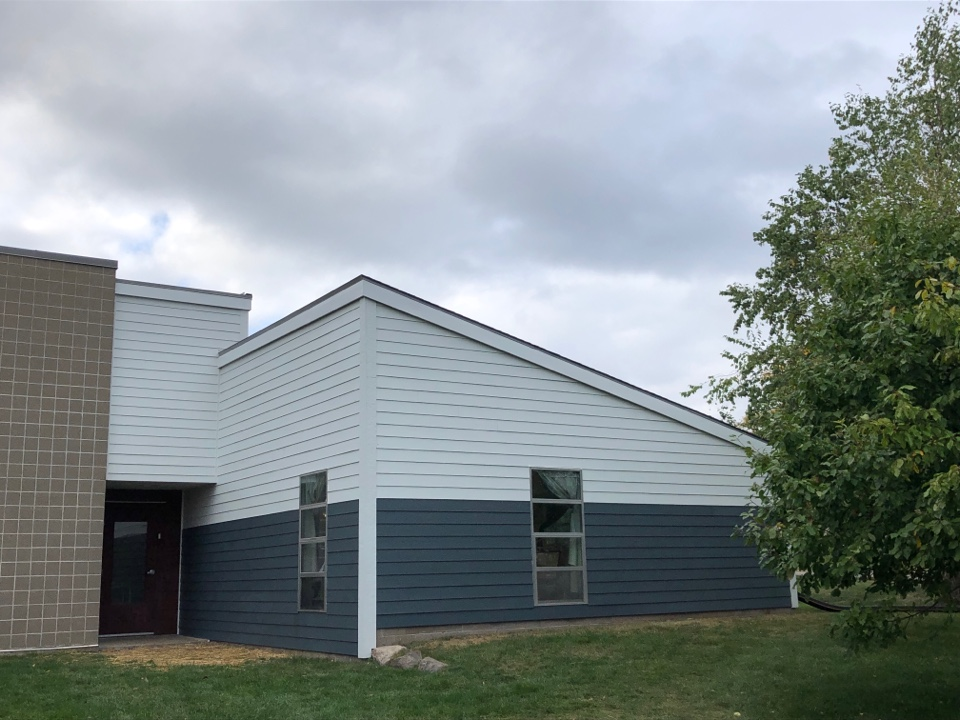 Madison, WI - James Hardie reside with Arctic White, Evening Blue, and Country Lane Red.