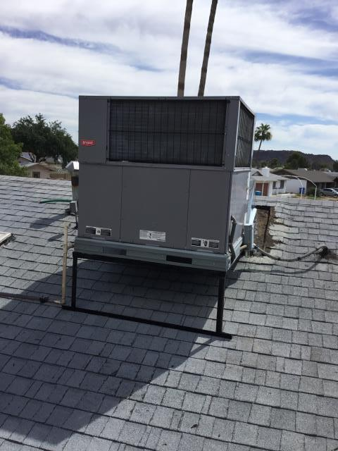Phoenix, AZ - Performing a preventative maintenance service near thunderbird road on a package heat pump Bryant system. System running great after washing coils and replacing filters.