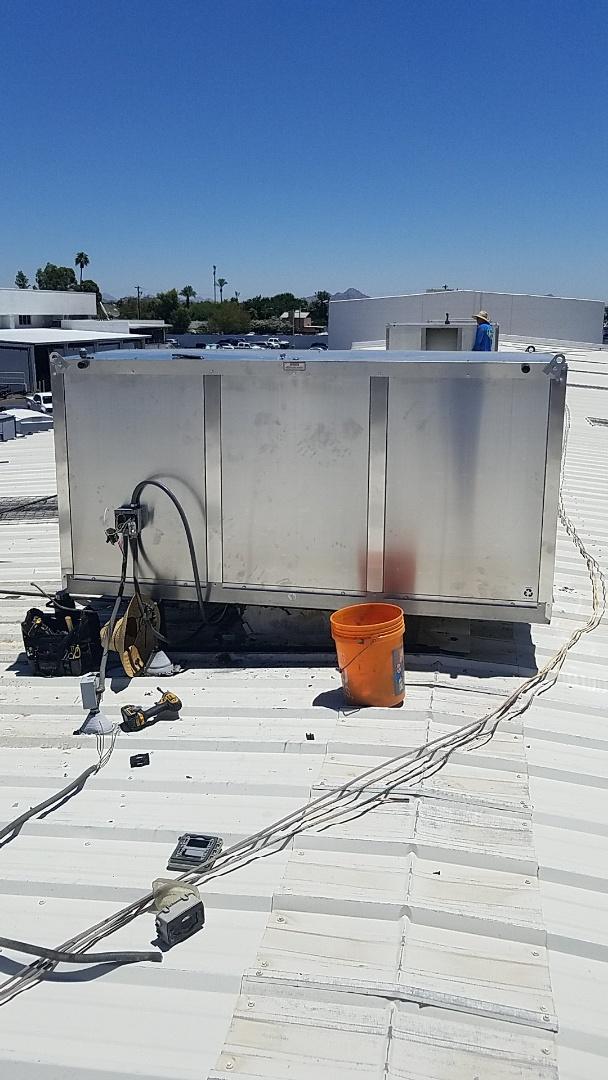Glendale, AZ - Installing new evap coolers at a car dealership Glendale