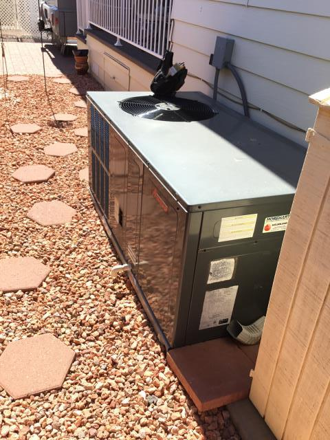 Surprise, AZ - At the Happy Trails Resort in Surprise performing maintenance on a Amana package heat pump unit.