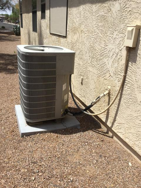Litchfield Park, AZ - In Litchfield Park area giving this customer a free estimate to replace his old Trane unit and replace it with a new Amana unit!