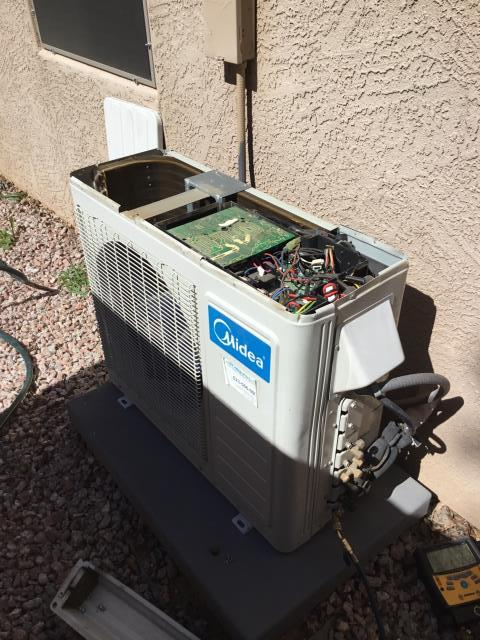 Phoenix, AZ - In Phoenix, Az performing a preventative maintenance service on a Midea unit. Changed air filters and did an acid wash to the exterior coil.